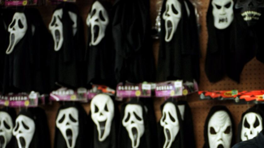 """A teen wearing a """"Scream"""" Halloween costume is accused of pointing a gun at a middle school teacher who was in class with students in Ontario."""