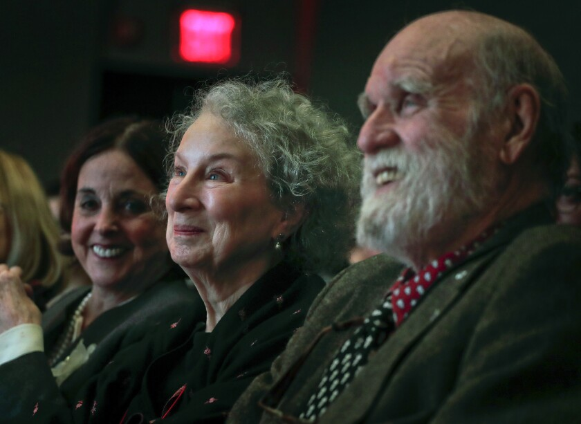 FILE - In this March 16, 2017 file photo, author Margaret Atwood, center, appears with her editor Nan Talese, left, and husband Graeme Gibson as she is introduced for the Ivan Sandrof Lifetime Achievement Award at the National Book Critics Circle awards ceremony in New York. Gibson, a Canadian novelist and conservationist has died. His death was announced Wednesday, Sept. 18, 2019 by Doubleday, which has published both Gibson and Atwood. He was 85 and had been suffering from dementia. (AP Photo/Julie Jacobson, File)