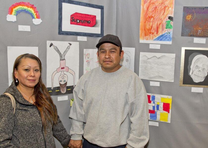 The Aguilar family came to see their son's drawing at the Boys and Girls Club art show