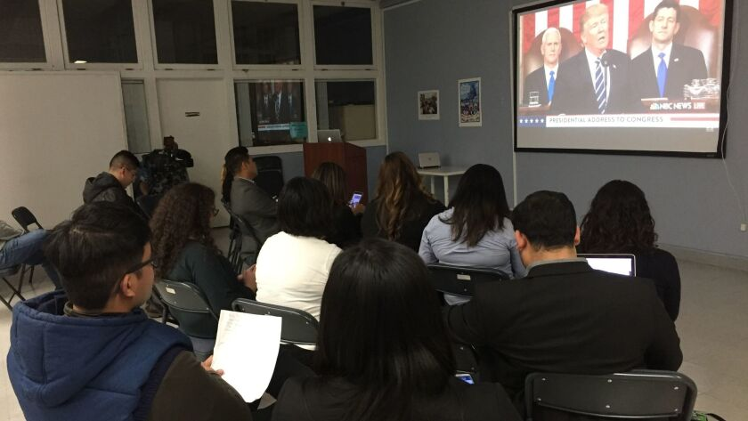 About a dozen people gathered Tuesday at UCLA's Labor Center to watch President Trump's speech to Congress.