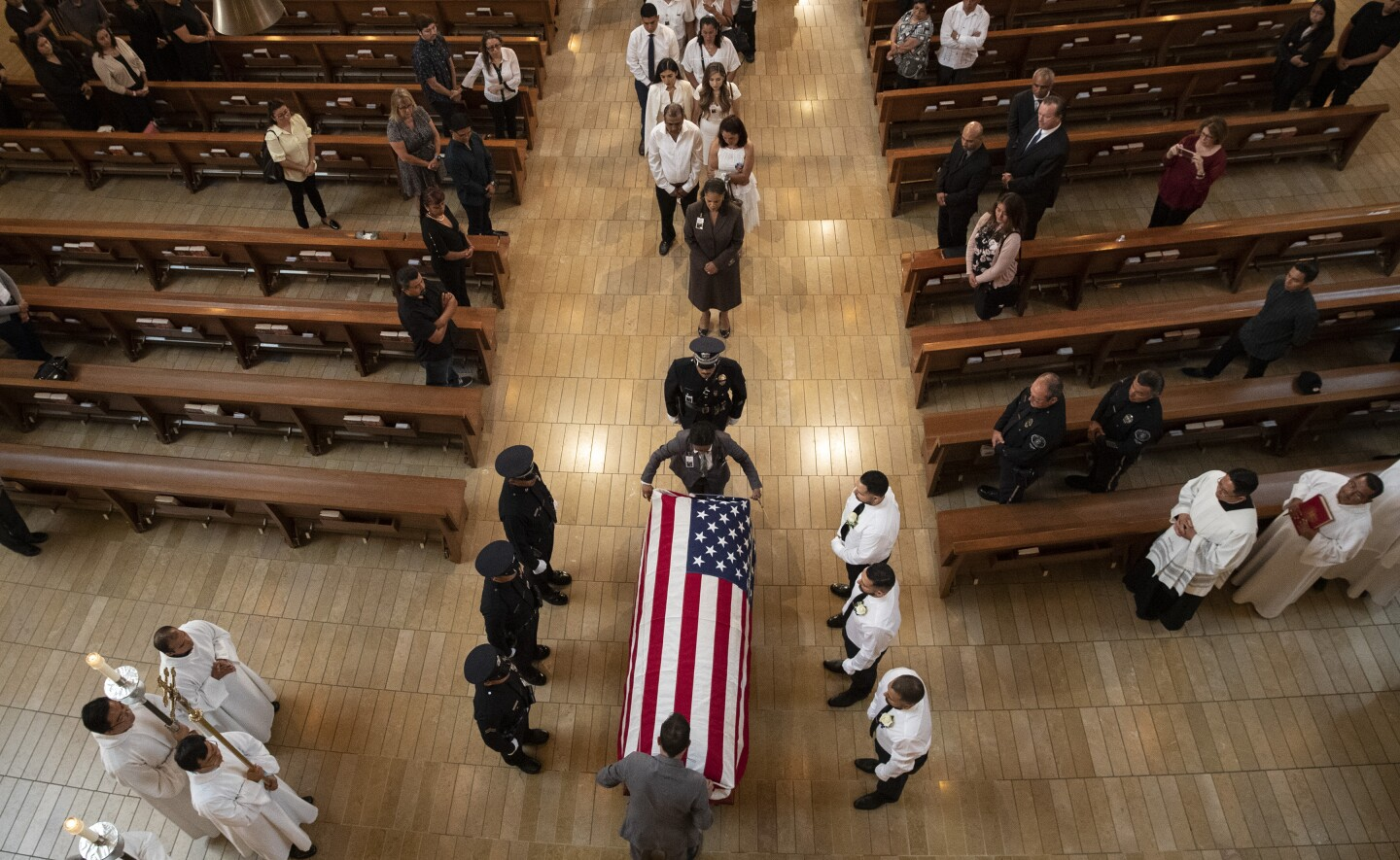 LOS ANGELES, CALIF. -- MONDAY, AUGUST 12, 2019: Pallbearers wait as an American flag is place on casket during funeral mass of slain LAPD officer Juan Diaz at the Cathedral of Our Lady of the Angels in Los Angeles, Calif., on Aug. 12, 2019. (Brian van der Brug / Los Angeles Times)