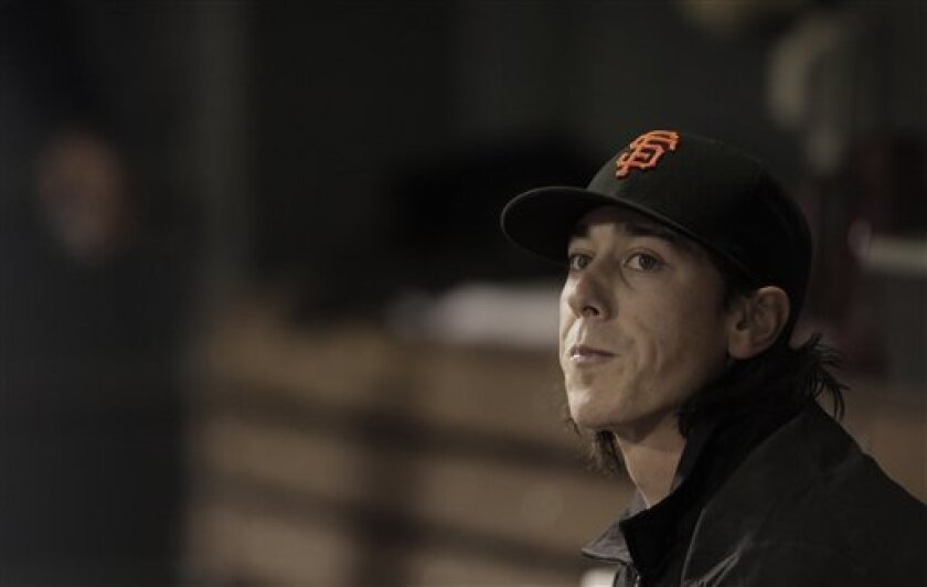 San Francisco Giants starting pitcher Tim Lincecum watches from the dugout after being taken out of baseball game against Colorado Rockies in the third inning in Denver, Wednesday, April 11, 2012. Lincecum gave up eight hits and six runs. (AP Photo/Joe Mahoney)