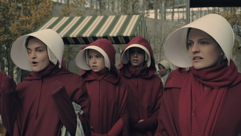 """Madeline Brewer, left and Elisabeth Moss, right, in """"The Handmaid's Tale."""""""