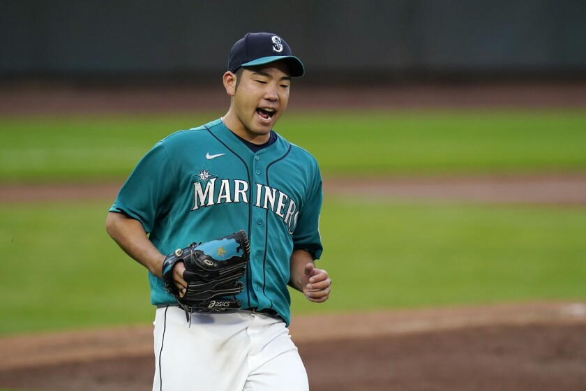 Seattle Mariners starting pitcher Yusei Kikuchi yells as Texas Rangers' Eli White grounds out in the third inning of a baseball game Friday, Sept. 4, 2020, in Seattle. (AP Photo/Elaine Thompson)