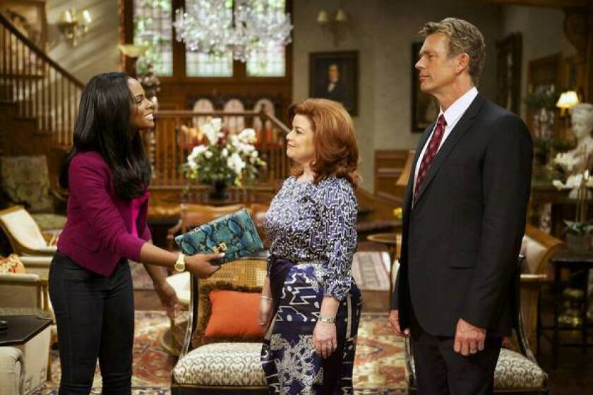 """Tika Sumpter, left, Renee Lawless and John Schneider in """"The Haves and the Have Nots."""""""