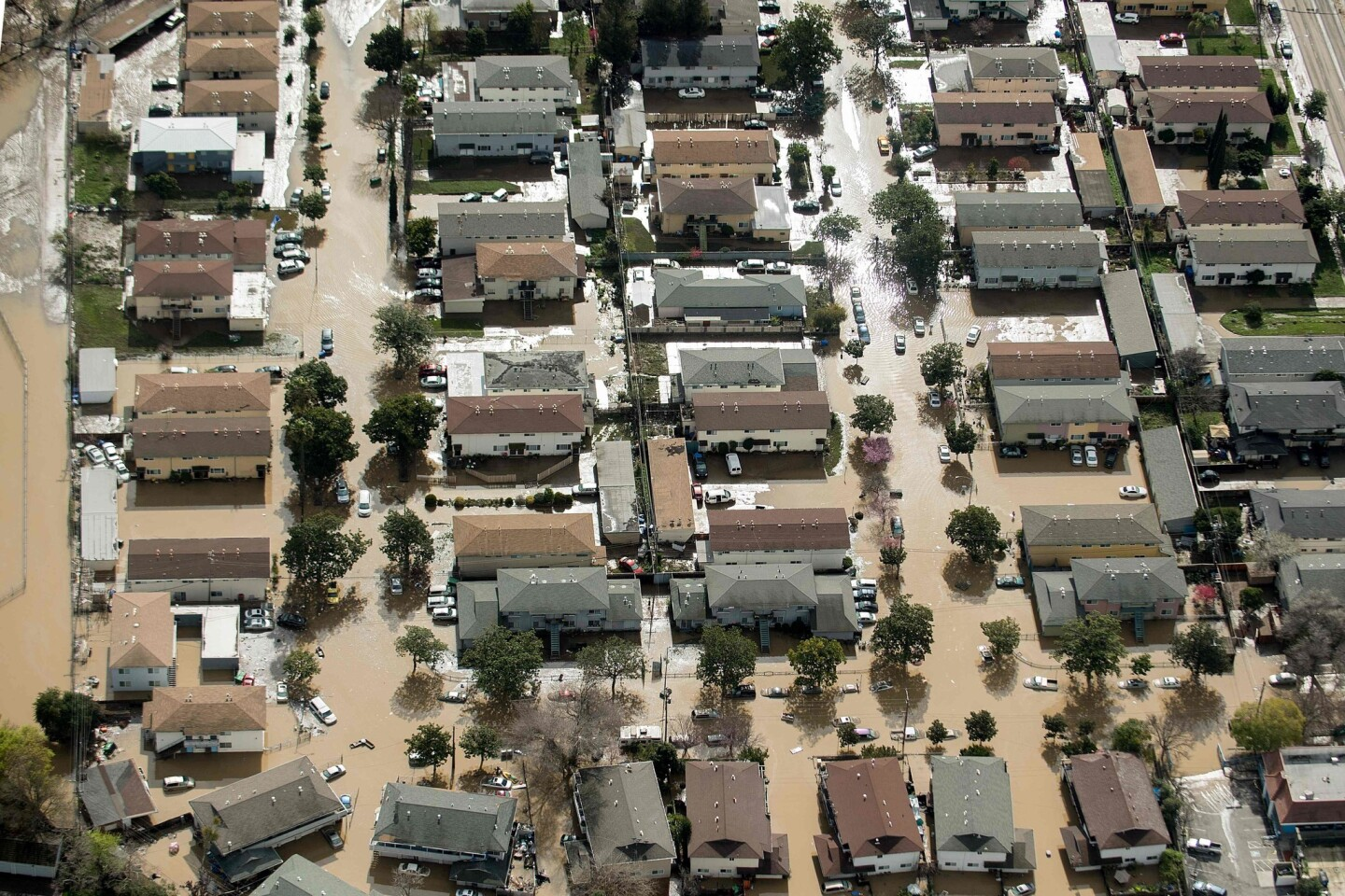 Floodwater surrounds homes in San Jose on Wednesday. Thousands of people were ordered to evacuate their homes as neighborhoods were inundated.