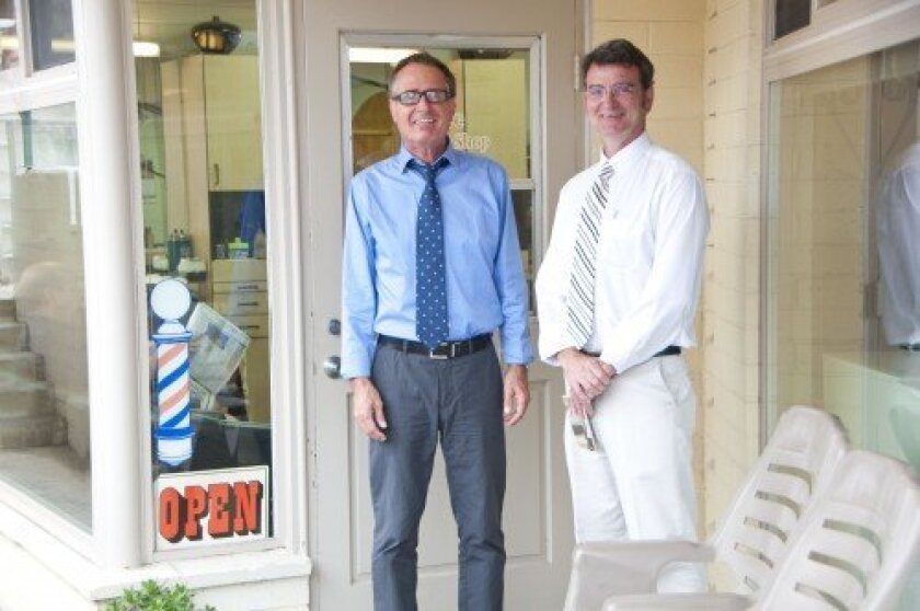 From left: Alton Rivera and owner David Schenk stand in front of Salon by the Cove, which has served the Solana Beach community for more than two decades.