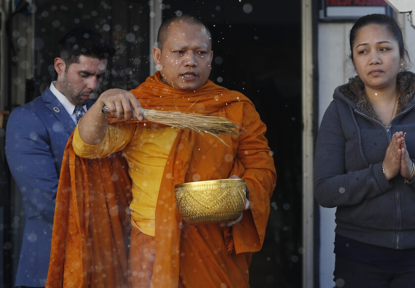 Buddhist monk performs a cleansing ritual  in Long Beach.
