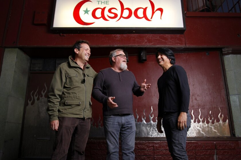 Tim Mays, center is the owner of the Casbah, which is celebrating its 25th anniversary, shown here with John Reis from Rocket From The Crypt and Mario Escovedo from The Dragons.