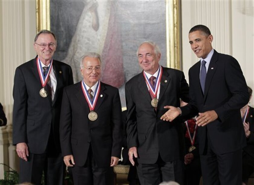 President Barack Obama stands with, from left, Marcian E. Hoff Jr., Federico Faggin, and Stanley Mazor, the creators of the world's first microprocessor at Intel Corporation, as he hosts a ceremony for recipients of the National Medal of Science and the National Medal of Technology and Innovation,
