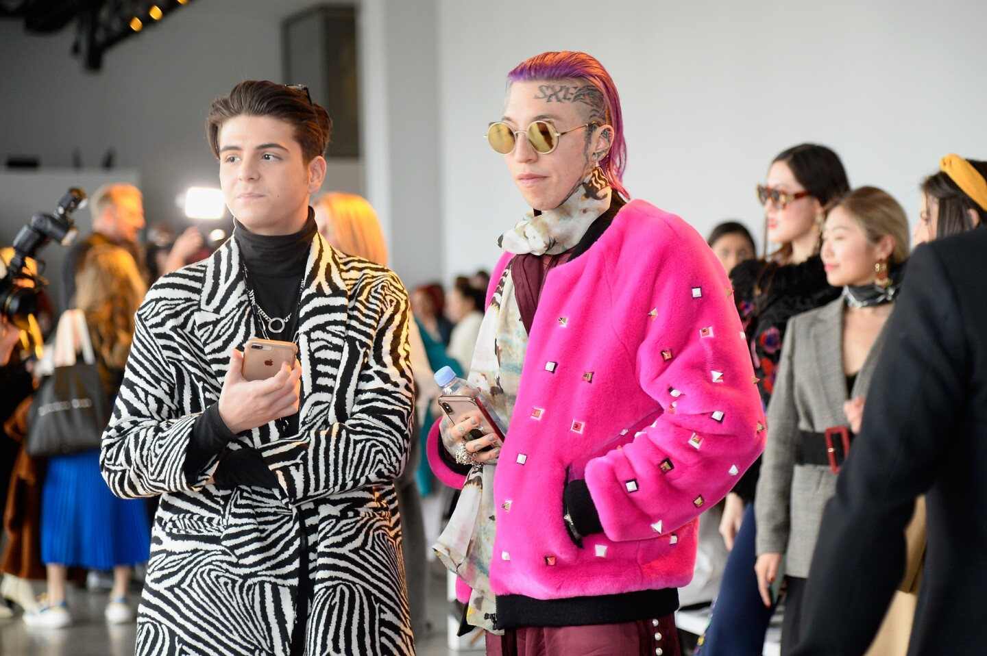 Chris Lavish (right) and guest backstage for Noon by Noor show during New York Fashion Week: The Shows at Gallery II at Spring Studios in New York City.