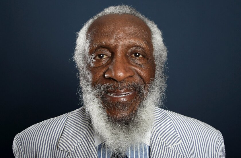 """FILE - In this July 21, 2012 file photo, comedian and activist Dick Gregory, from the upcoming documentary film """"Soul Food Junkies,"""" poses for a portrait during the PBS TCA Press Tour in Beverly Hills, Calif. A play about Gregory will open off-Broadway this spring starring Joe Morton and with an original song by John Legend. """"Turn Me Loose,"""" by Gretchen Law will play the Westside Theatre starting May 3, 2016, under the direction of John Gould Rubin. (Photo by Matt Sayles/Invision/AP, File)"""