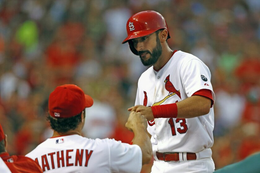 St. Louis Cardinals' Matt Carpenter is congratulated by manager Mike Matheny after hitting his second home run of the game during the fifth inning of a baseball game against the Colorado Rockies, Thursday, July 30, 2015, in St. Louis. (AP Photo/Billy Hurst)