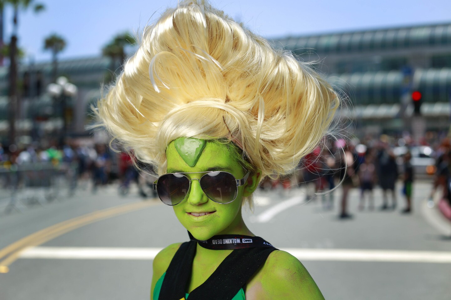 Sabrina Welke of Simi Valley dressed as Peridot at Comic-Con in San Diego on July 20, 2017. (Photo by K.C. Alfred/The San Diego Union-Tribune)