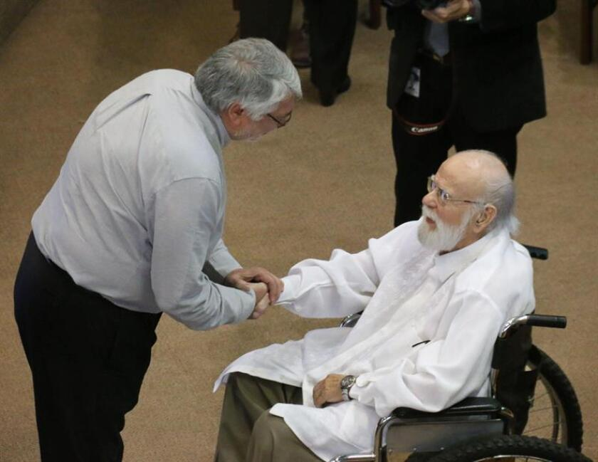 Senator Fernando Lugo honors the artista and activist Joel Filártiga at the Paraguay Senate Nov. 8 2018, in Asuncion (Paraguay). EPA-EFE/Alejandro R. Otero