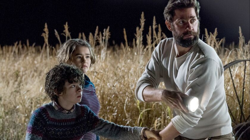 "From left, Noah Jupe plays Marcus Abbott, Millicent Simmonds plays Regan Abbott and John Krasinski plays Lee Abbott in ""A Quiet Place."""