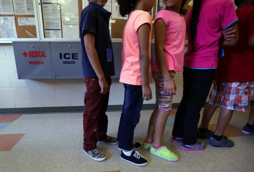 Children line up in the cafeteria at the immigration detention center in Karnes City, Texas.