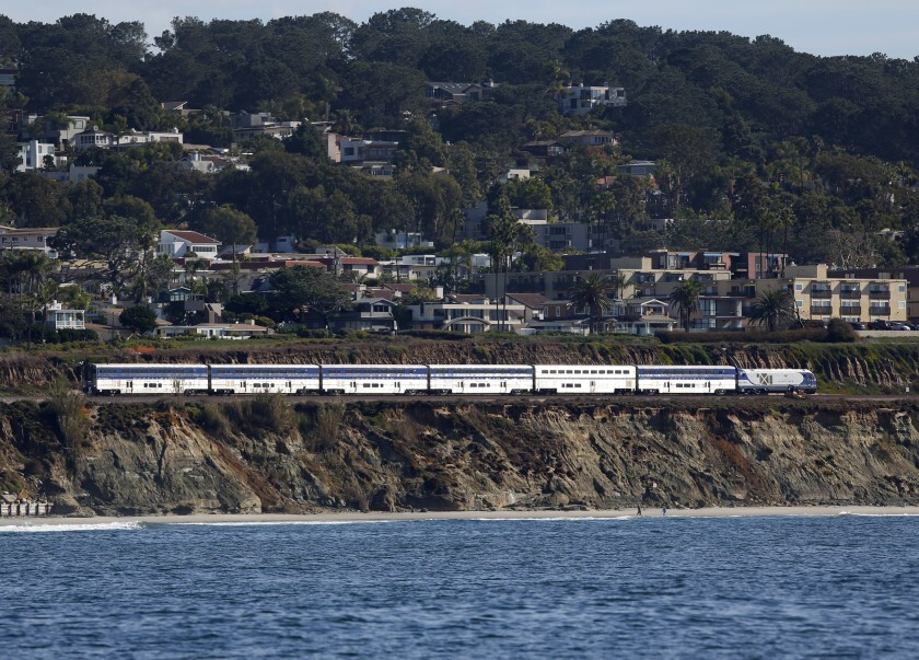 The Amtrak Surfliner train heads north along the tracks in Del Mar on Dec. 5, 2019. Trains were slowed down while passing through the area following a bluff collapse in November that required emergency stabilization of the cliff.