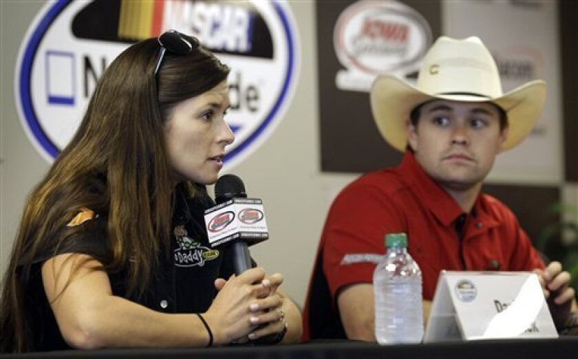 FILE - In this May 19, 2012 file photo, Danica Patrick speaks during a news conference as Ricky Stenhouse Jr., right, looks on before qualifying for the NASCAR Nationwide Series' Pioneer Hi-Bred 250 auto race at Iowa Speedway in Newton, Iowa. Patrick slid into her chair at NASCAR media day Thursday