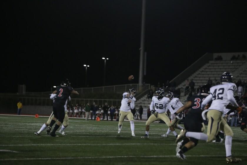 Birmingham quarterback Jackson Dadich throws a pass against Banning on Nov. 29, 2019.