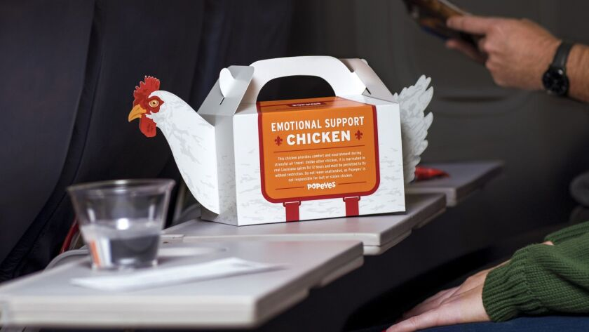 Popeyes Louisiana Kitchen is offering chicken meals in carry-on boxes that resemble chickens at Philadelphia International Airport.