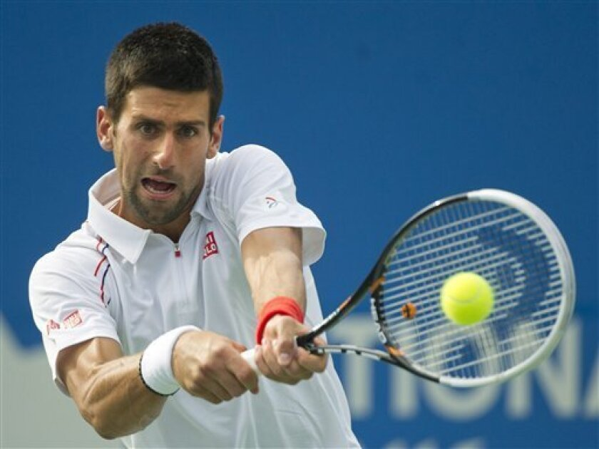 Novak Djokovic of Serbia returns the balll against Sam Querrey of the United States during 2012 Rogers Cup tennis action in Toronto on Friday, Aug. 10, 2012. Djokovic defeated Querrey 6-4 ,6-4. (AP Photo/The Canadian Press, Nathan Denette