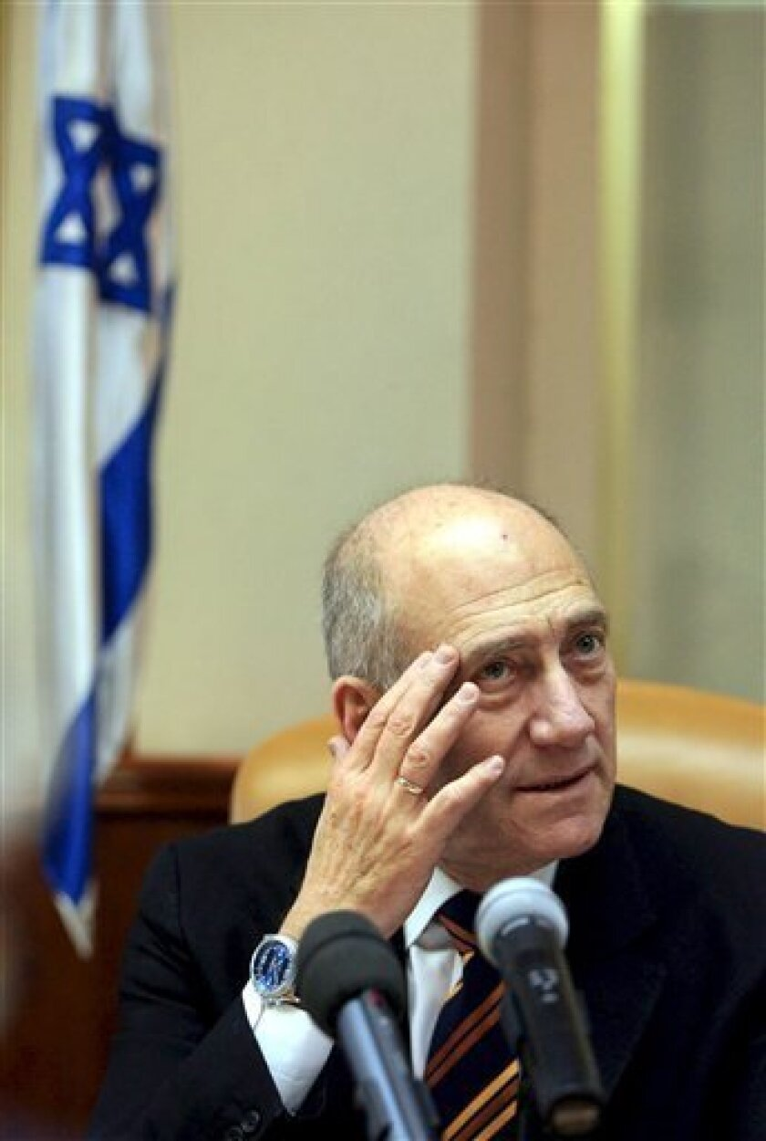 Israeli prime Minister Ehud Olmert attends the weekly cabinet meeting in Jerusalem, Sunday, Nov. 30, 2008. Israeli Foreign Minister Tzipi Livni on Thursday called on the country's embattled prime minister to step down immediately in light of growing signs that he will soon be indicted on corruption charges. (AP Photo/Pavel Wolberg, Pool)