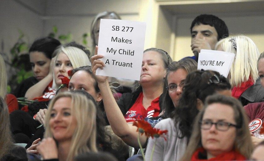 "Opponents of SB 277, which would end the ""personal beliefs"" exemption, attend the Senate Education Committee meeting where the panel approved the bill."