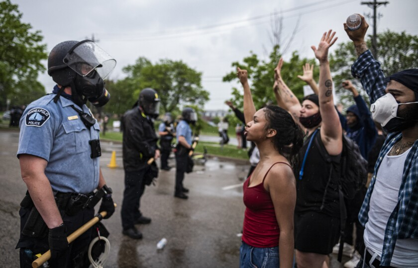 Demonstrators and Minneapolis police face each other May 26 during a protest after the death of George Floyd.
