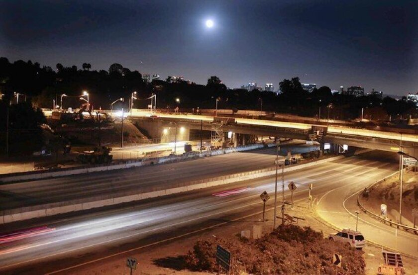 The Sunset Boulevard bridge, at the middle of this frame, was closed in July 2010 as part of the widening project on the 405 Freeway. The seismically upgraded span is scheduled to reopen Monday -- a huge relief to neighborhood residents.