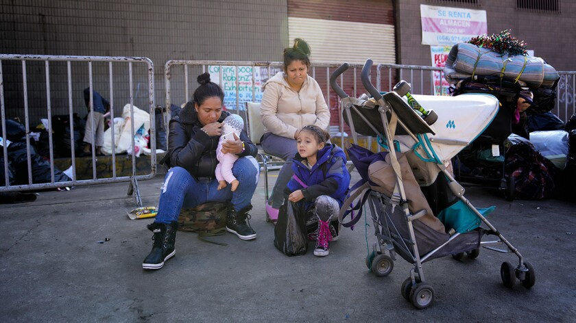 Claudia Hernandez (left) along with her six-year old daughter, Angelina and friend Fernanda Zuniga (right) were among the last group that was evicted from the Contra Viento y Marea, temporary shelter in Tijuana.