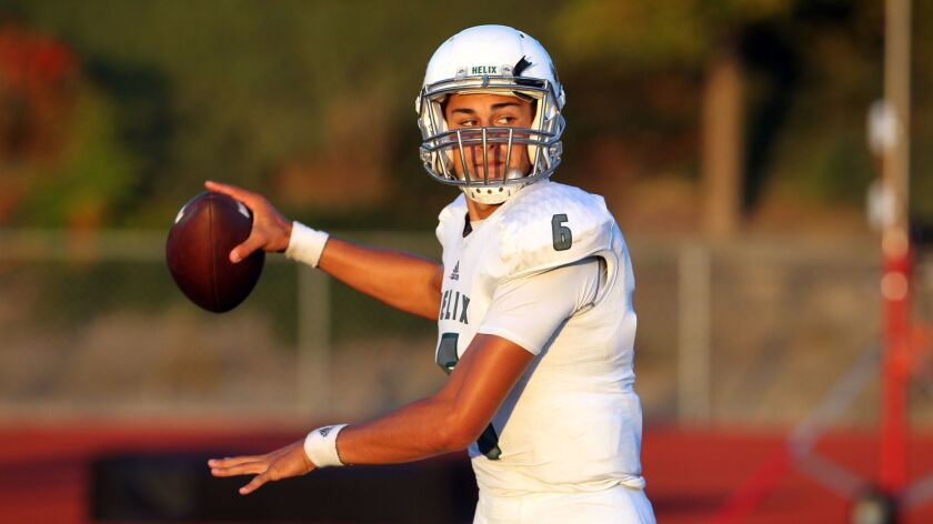 Helix quarterback Carson Baker was 15-of-22 passing for 159 yards and a touchdown with three interceptions.
