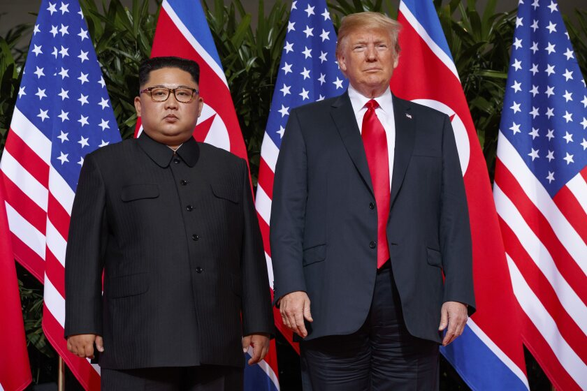 FILE - In this June 12, 2018, file photo, U.S. President Donald Trump, right, meets with North Korean leader Kim Jong Un on Sentosa Island, in Singapore. North Korea on Friday, June 12, 2020 again vowed to build up its military force to counter what it perceives as U.S. threats and said there would be little reason for a personal relationship between leader Kim Jong Un and President Donald Trump if Washington persists with sanctions and pressure. (AP Photo/Evan Vucci, File)
