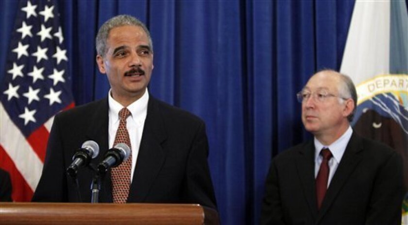 Attorney General Eric Holder, and Department of the Interior Secretary Ken Salazar, make an announcement on the settlement of Cobell lawsuit on Indian Trust Management at the Interior Department in Washington, Tuesday, Dec. 8, 2009 in Washington. (AP Photo/Manuel Balce Ceneta)