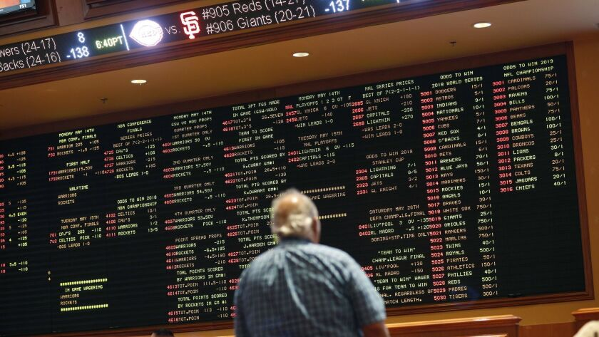 In this Monday, May 14, 2018 photo, betting odds are displayed on a board in the sports book at the