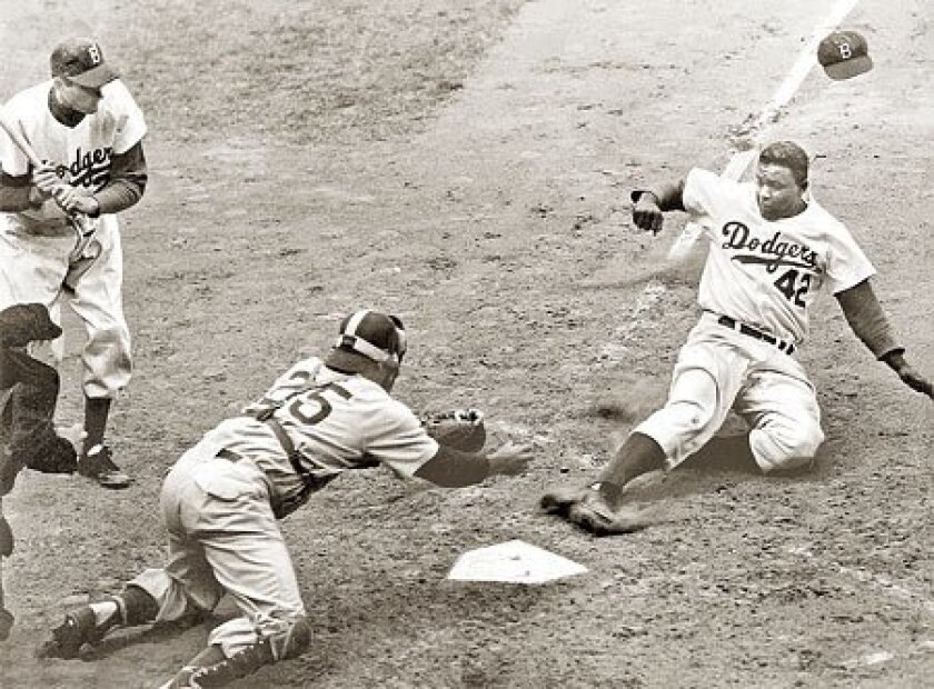 Jackie Robinson was known to dazzle fans and rattle teams with daring thefts of home plate. (The New York Times archive)
