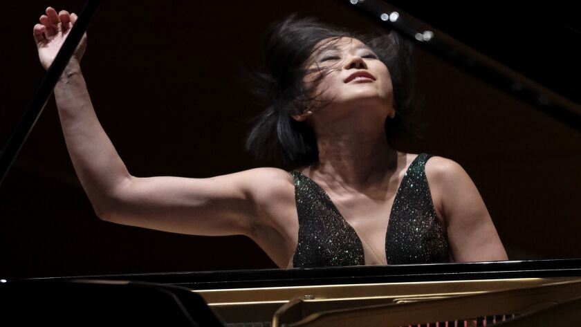 Pianist Yuja Wang returns to Walt Disney Concert Hall to perform a new concerto by John Adams with the Los Angeles Philharmonic.