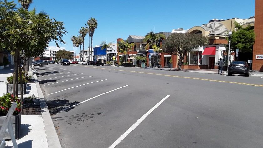 Days following the state's stay-at-home mandate and order to close all non-essential businesses results in a rare for a mid-day, nearly empty Girard Avenue in La Jolla. Gov. Gavin Newsom's March 19, 2020 executive order calls for California's 40 million residents to stay home indefinitely and venture outside only for essential jobs and errands, acquiring food, seeking medical care or getting some exercise.