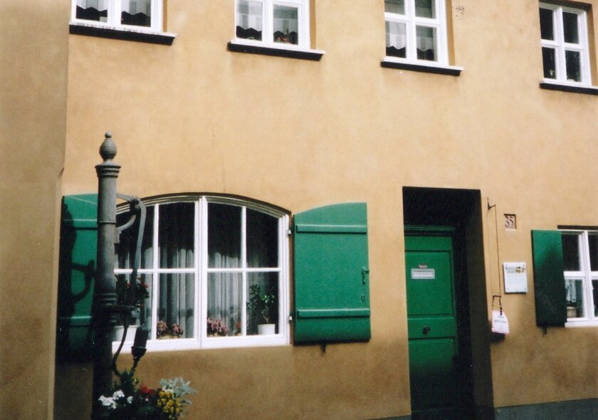 The charming cottages at the Fuggerei in Augsburg, Germany, are well kept by the residents, who pay an annual rent of .88 euro cents, or about $1.