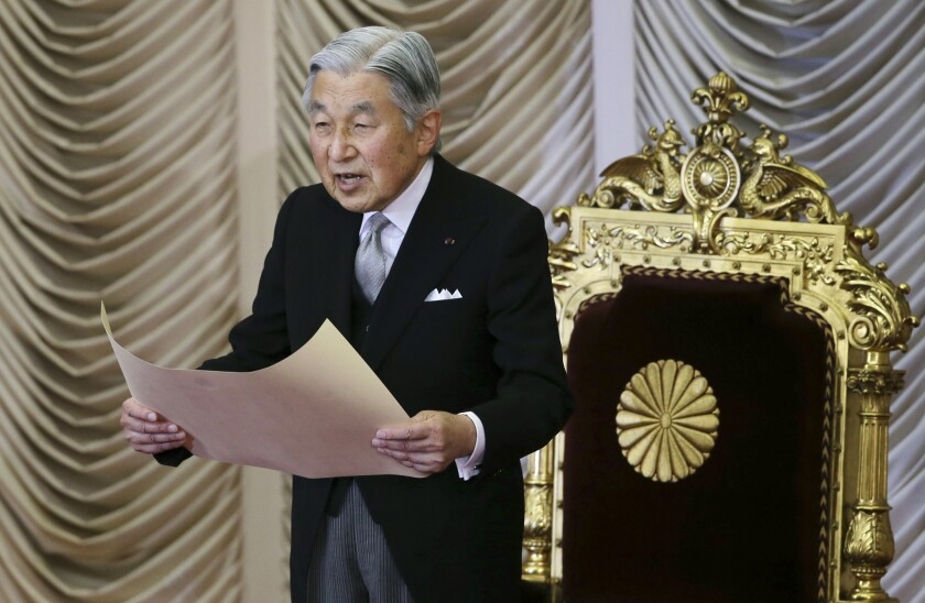 Japan's Emperor Akihito reads a statement to formally open the extraordinary Diet session at the upper house of parliament in Tokyo on Aug. 1.