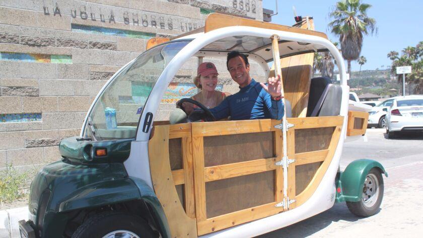 Surfer couple Margo Schwab and Scott Johnston arrive to La Jolla Shores aboard the Surfmobile.