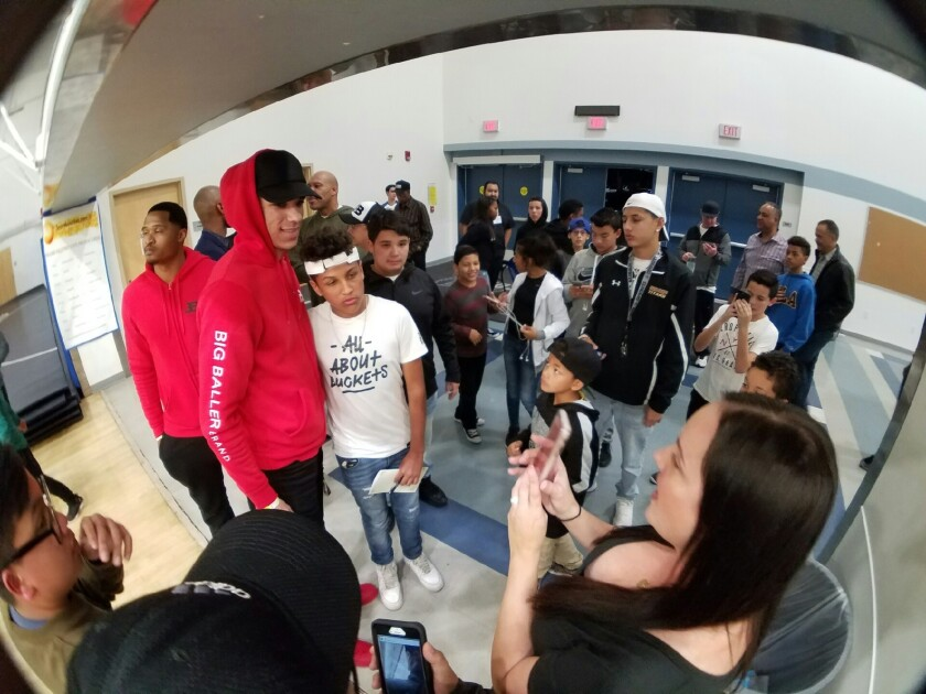 UCLA freshman Lonzo Ball was posing for photos and signing autographs while watching his brothers play for Chino Hills on Saturday night at Cerritos College.
