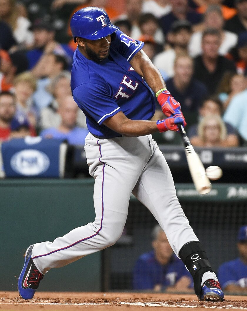 Texas Rangers' Elvis Andrus hits a solo home run off Houston Astros starting pitcher Mike Fiers during the second inning of a baseball game Saturday, May 21, 2016, in Houston. (AP Photo/Eric Christian Smith)