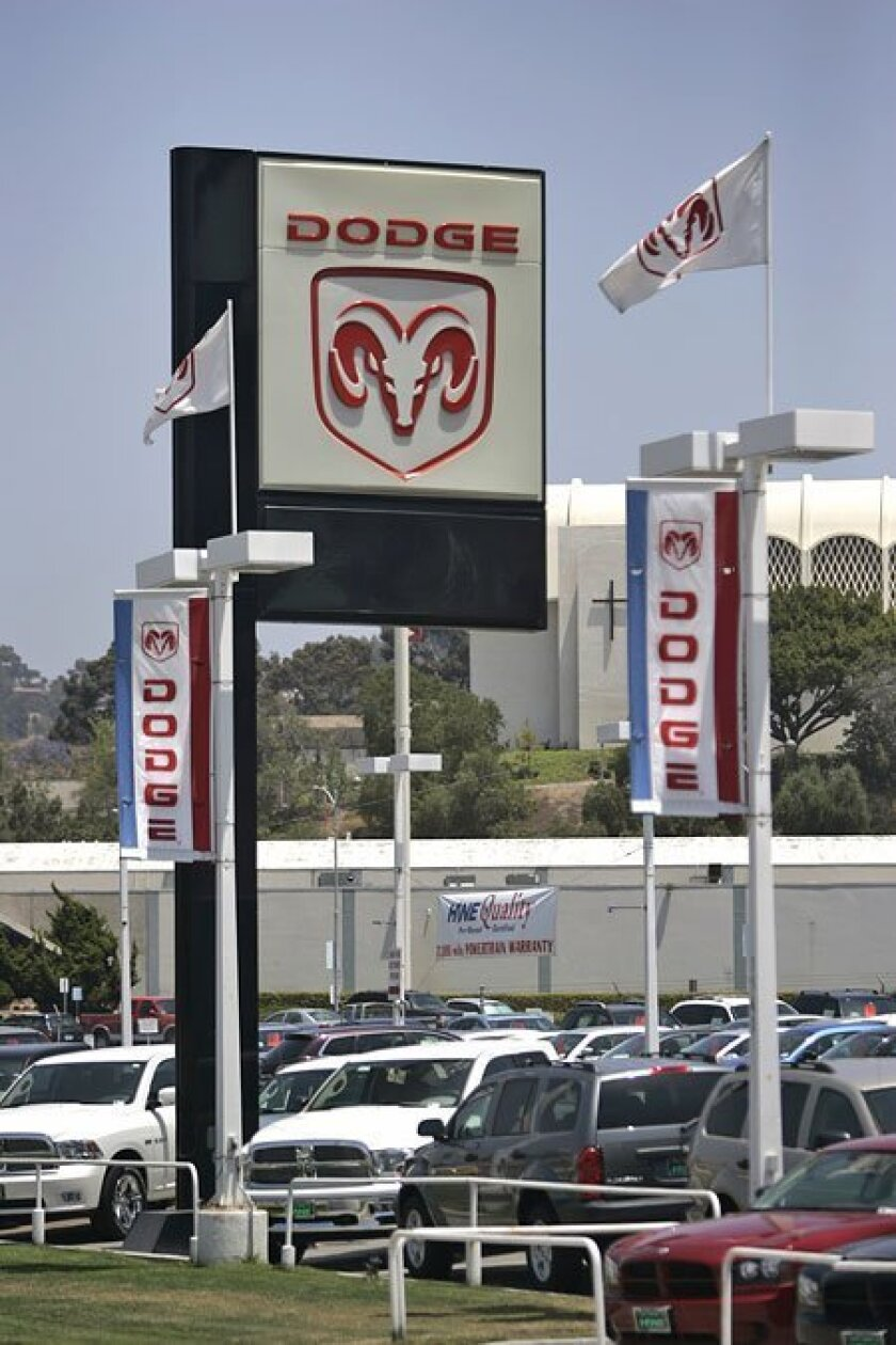 Dave Miller of John Hine Dodge in San Diego said the dealership may pick up another automaker's line after it is dropped as a Chrysler franchisee. Hine also carries Mazda and, until it is phased out next year, Pontiac. (Eduardo Contreras / Union-Tribune)