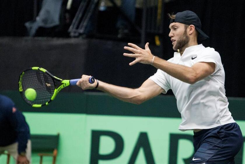 Jack Sock of the USA returns a shot during the doubles match against Joran Vliegen and Sander Gille of Belgium at the Davis Cup World Group quarterfinals in Nashville, Tennessee, USA, 07 April 2018. EFE