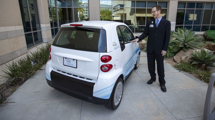 Mark Giavinic, the director of rehabilitation services, shows how a car will be used to help patient