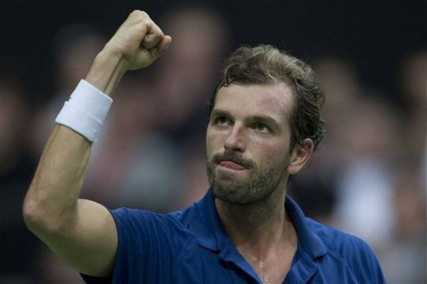 Julien Benneteau of France celebrates defeating compatriot Gilles Simon in the semi final match at the ABN AMRO world tennis tournament at Ahoy Arena in Rotterdam, Netherlands, Saturday Feb. 16, 2013. Benneteau won in two sets 6-4, 7-6 and will play Argentina's Juan Martin del Potro in the final Sunday. (AP Photo/Peter Dejong)