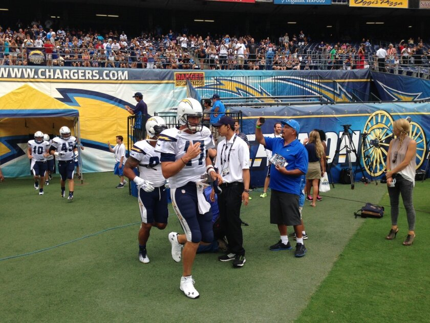 Chargers Quarterback Philip Rivers takes the field at Chargers Fan Fest 2014, Saturday Aug. 2, at Qualcomm Stadium.