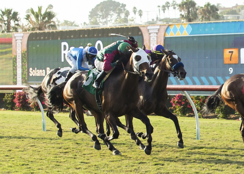 Pulpit Rider and jockey Juan Hernandez, outside, overpower win the $125,000 Solana Beach Stakes.