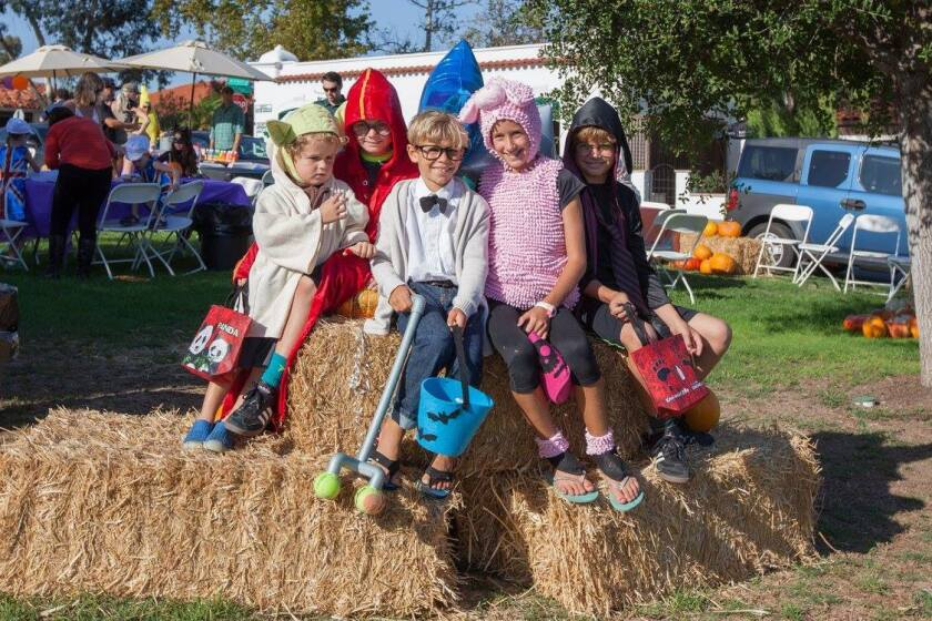 Kids enjoy last year's Halloween in the village.